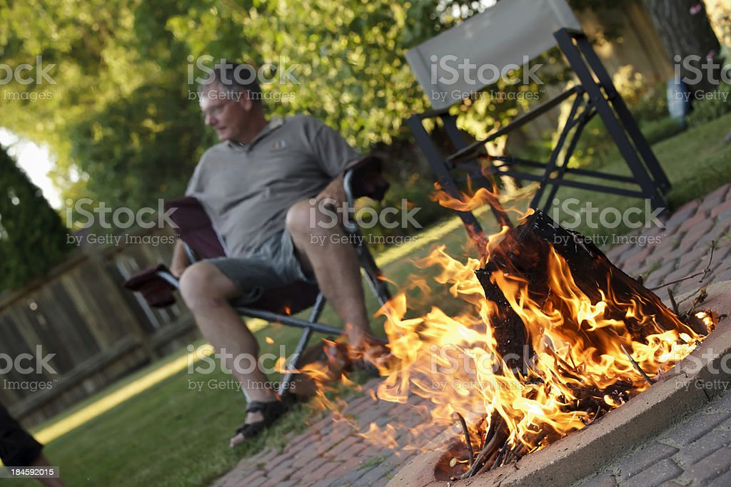 Friends by Camp Fire stock photo