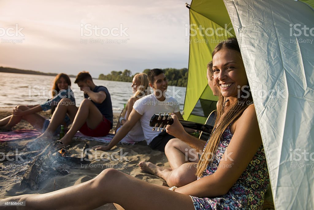 Friends camping at the beach stock photo