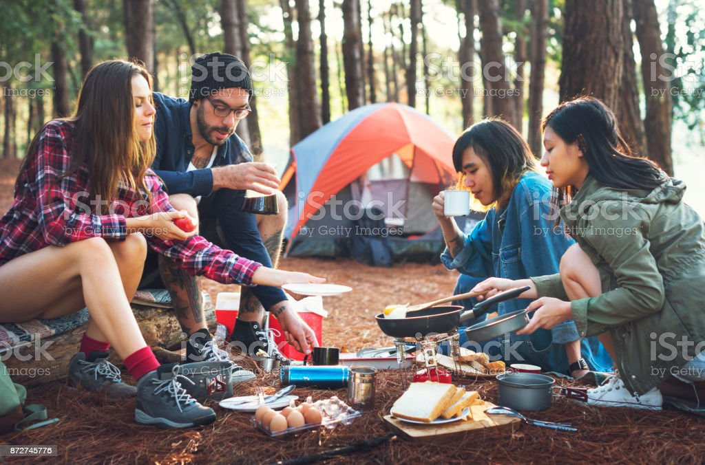 Friends camping in the forest stock photo