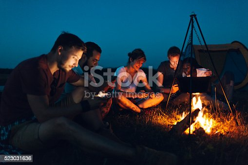 istock Friends camping together in nature 523031636