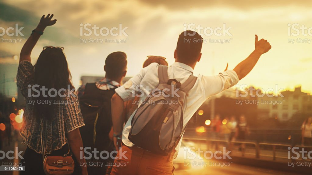 Friends catching a ride. stock photo