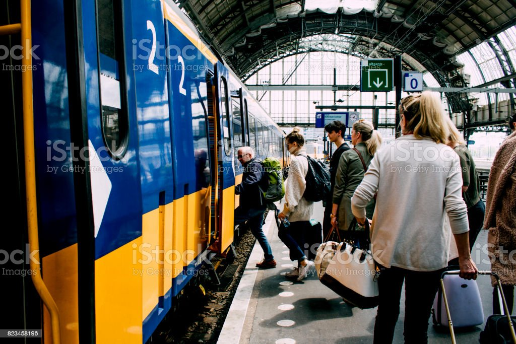 Friends Catching The Train In Amsterdam stock photo