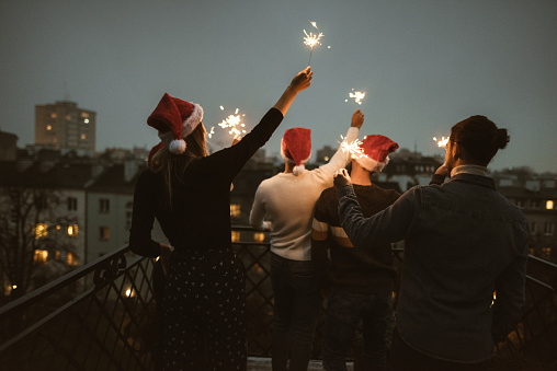 friends celebrate the christmas on the rooftop