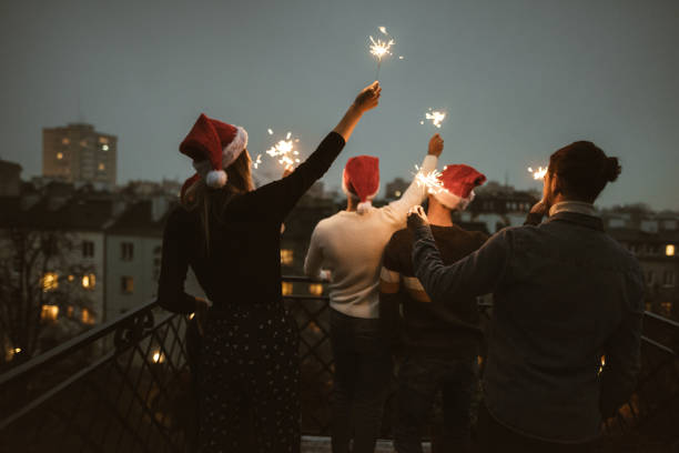 friends celebrate the christmas on the rooftop stock photo