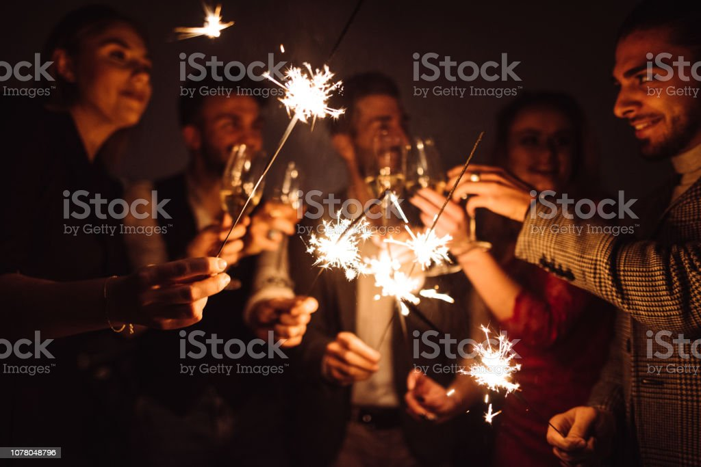 friends celebrate the new year on the rooftop stock photo