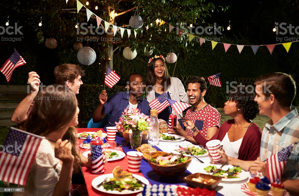 Friends Celebrating 4th Of July Holiday With Backyard Party stock photo