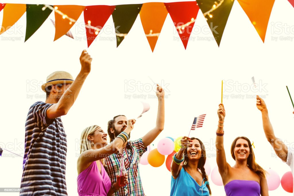Friends celebrating 4th of July stock photo