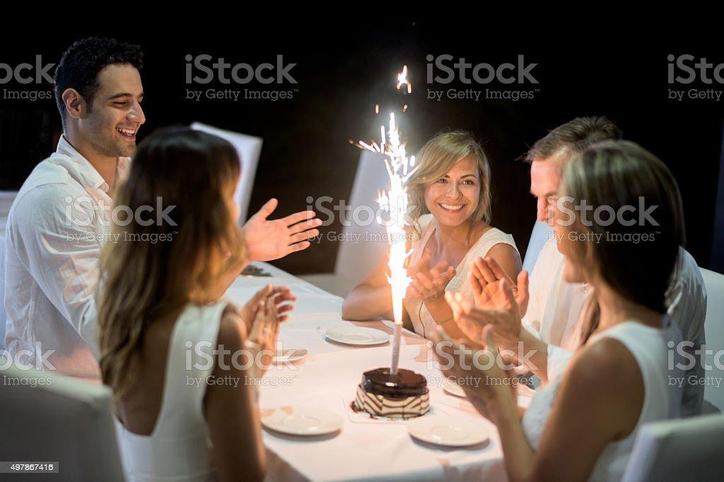 Friends celebrating a birthday stock photo