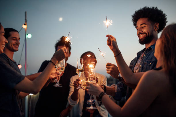 friends celebrating at party on rooftop - vacations food stock pictures, royalty-free photos & images