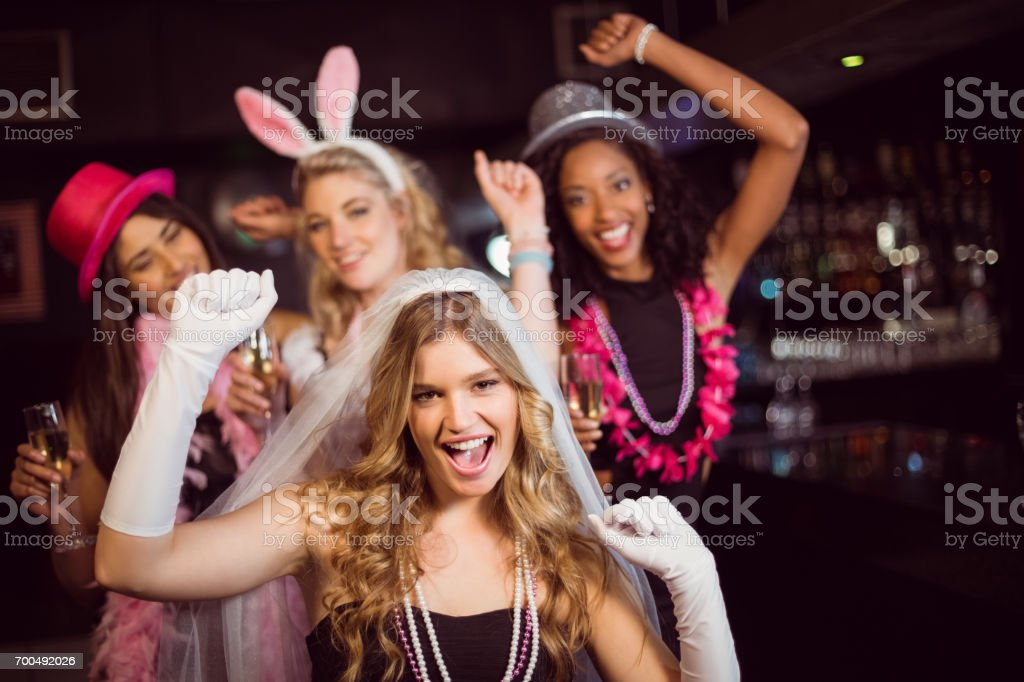 Friends celebrating bachelorette party stock photo