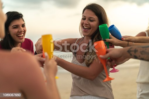 istock Friends Celebrating Beach Holiday Party 1089067650