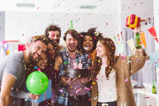 friends celebrating birthday party in the office - 30 te urodziny zdjęcia i obrazy z banku zdjęć