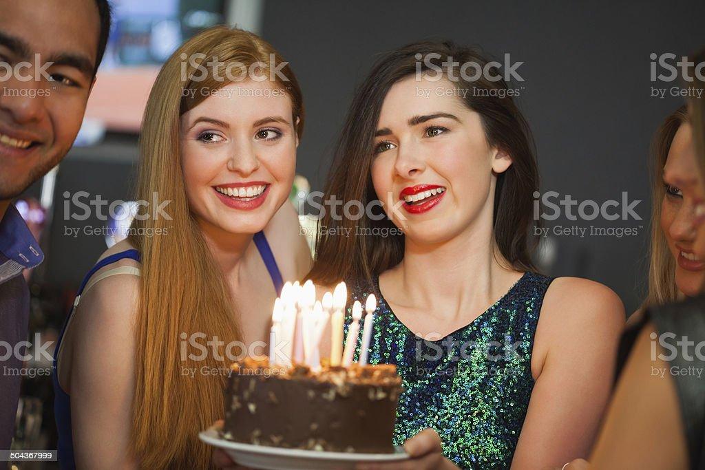 Friends celebrating birthday together stock photo