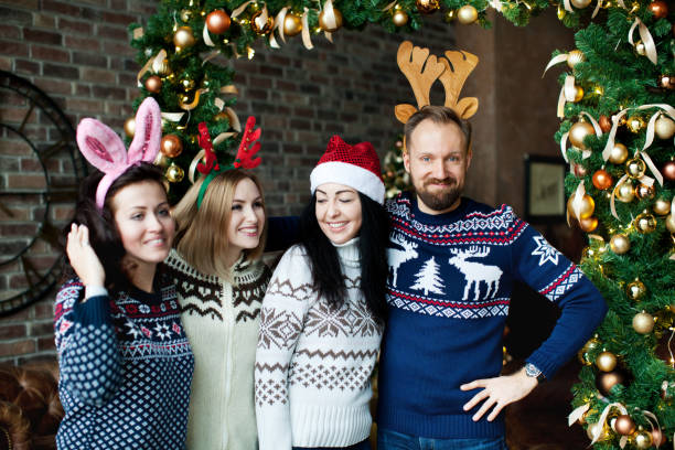 Friends celebrating Christmas at home stock photo