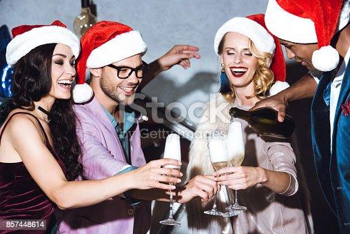 istock friends celebrating christmas 857448614