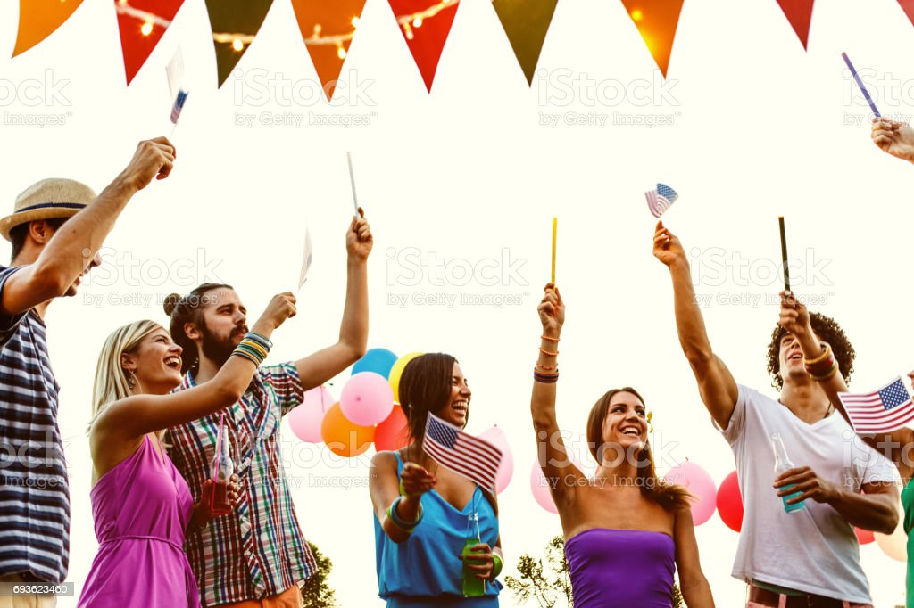 Friends celebrating Independence day stock photo
