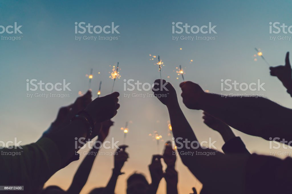 Friends celebrating New Year on the rooftop stock photo
