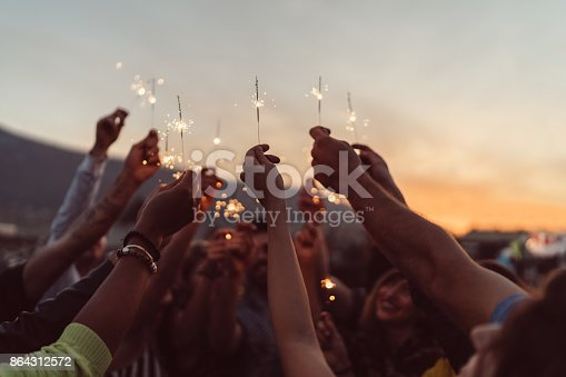 istock Friends celebrating New Year on the rooftop 864312572