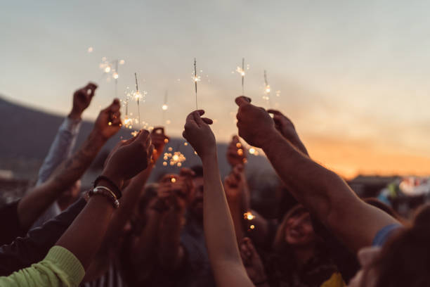 friends celebrating new year on the rooftop - unity stock pictures, royalty-free photos & images