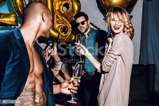 istock friends celebrating new year 857450332