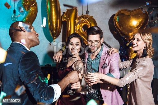 istock friends celebrating new year 857450672
