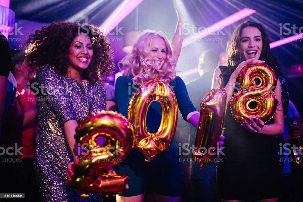 Friends celebrating New Years eve party in a club stock photo