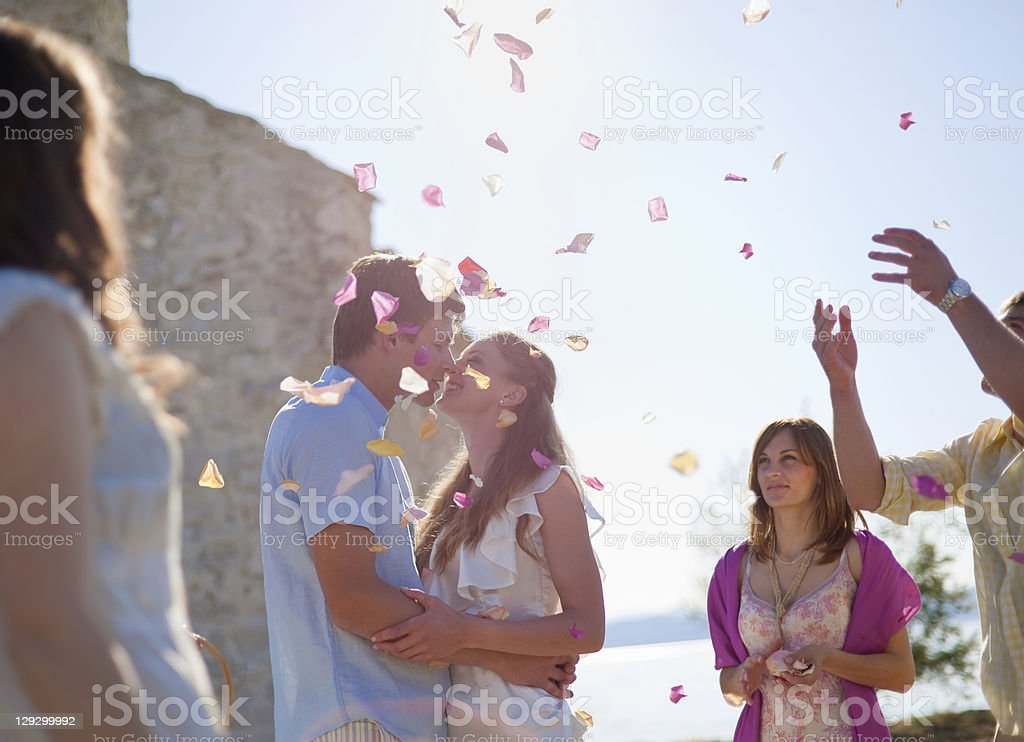 Friends celebrating newlywed couple stock photo