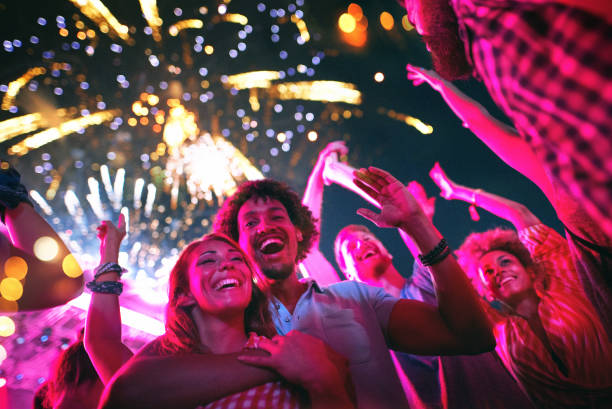 Friends celebrating on a night out. stock photo