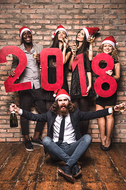 Friends celebrating the new year 2018 together standing stock photo