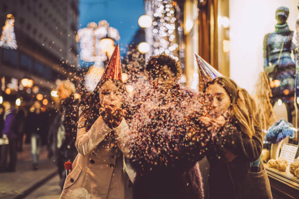 Friends celebrating the New Year's Eve Friends celebrating the New Year's Eve new year's eve stock pictures, royalty-free photos & images