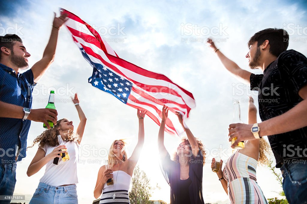 Friends celebrating US Independence Day stock photo