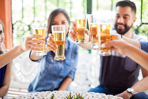 Friends celebrating with a toast stock photo
