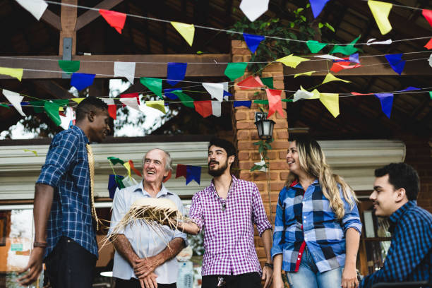 Friends chatting during the Brazilian Junina Party stock photo