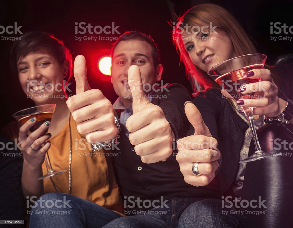 Friends cheering at disco club royalty-free stock photo