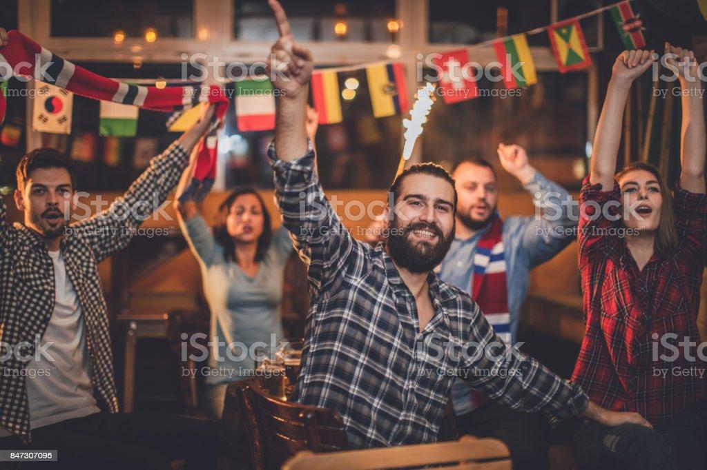 Friends cheering stock photo