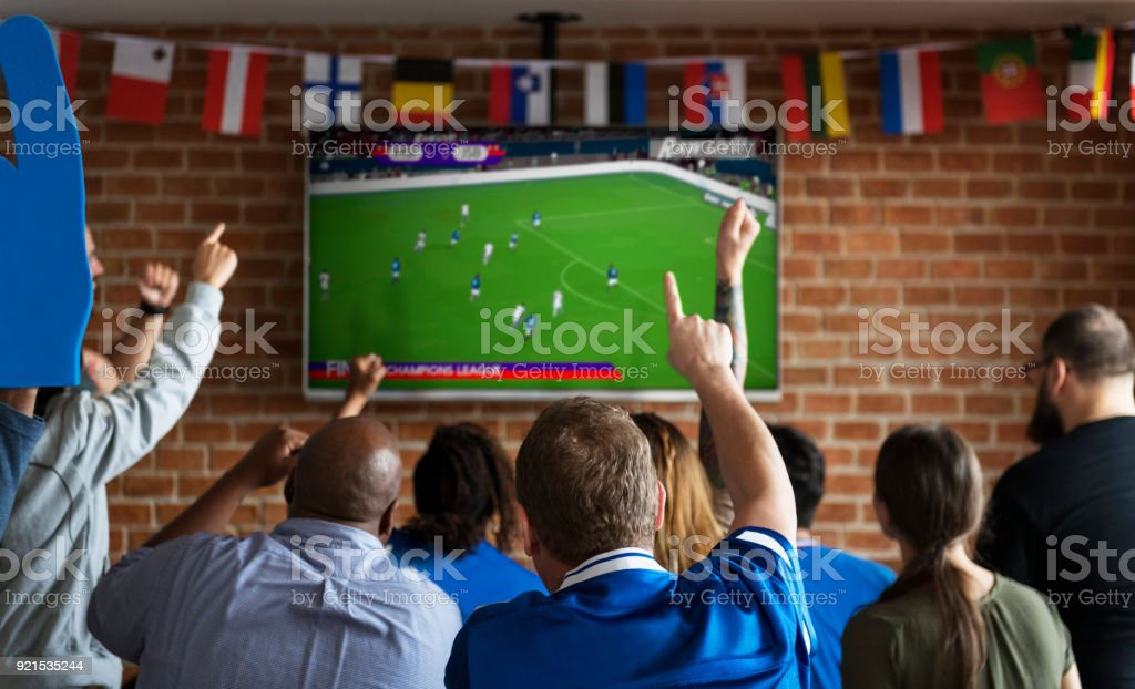 Friends cheering sport at bar together royalty-free stock photo