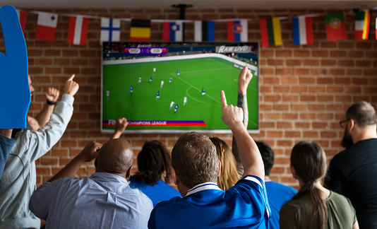 Friends Cheering Sport At Bar Together Stock Photo - Download Image Now