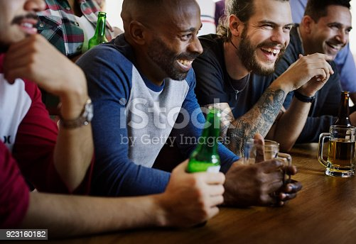 istock Friends cheering sport at bar together 923160182