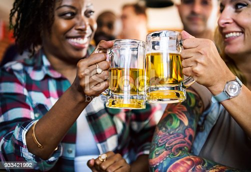 istock Friends cheering sport at bar together 933421992