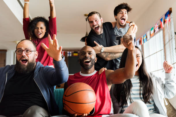Friends cheering sport league together Friends cheering sport league together eastern european descent stock pictures, royalty-free photos & images