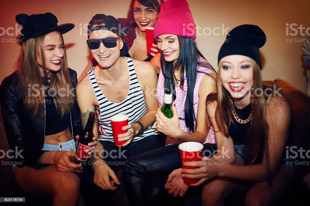 Friends Chilling at Club Party stock photo