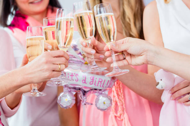 friends clinking glasses on baby shower party - baby party stock-fotos und bilder