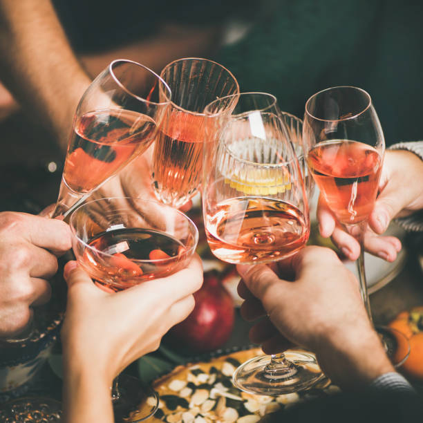 Friends clinking glasses with rose wine at christmas square crop picture id1070084812?b=1&k=6&m=1070084812&s=612x612&w=0&h=9mszpxmyyta ixqub6gczxf7ye kyrc2btjtmfxdlkk=