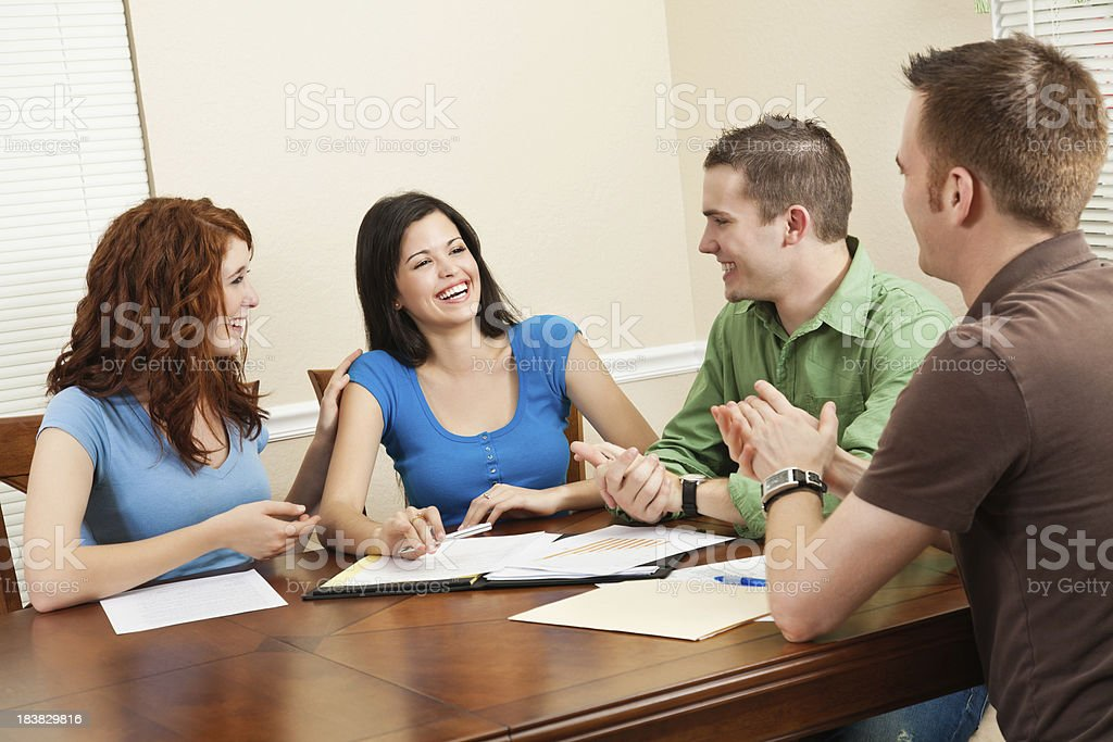 Friends Congratulating Friend During Study Group Time royalty-free stock photo