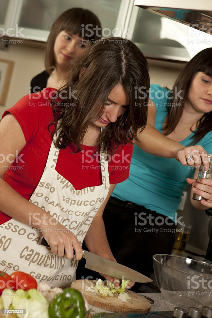 friends cooking together royalty-free stock photo
