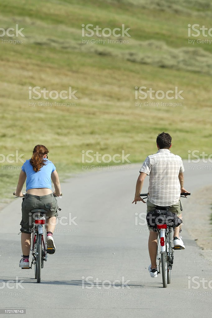 Friends cycling royalty-free stock photo