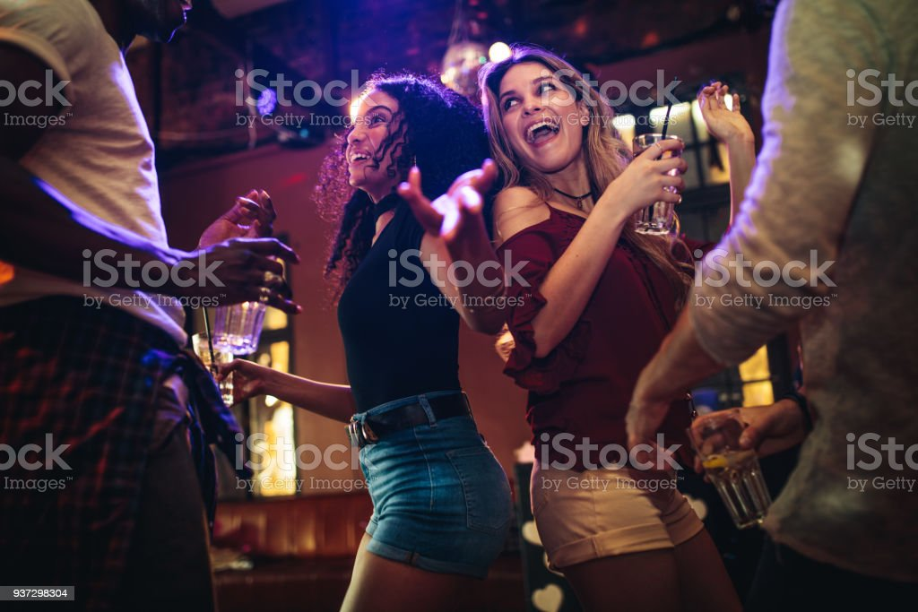 Friends dancing and partying at nightclub stock photo