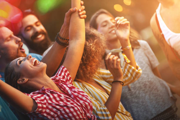 Friends dancing at a concert. stock photo