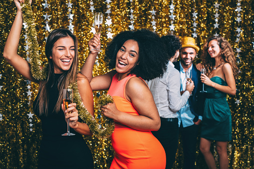 Friends dancing at a new year's party