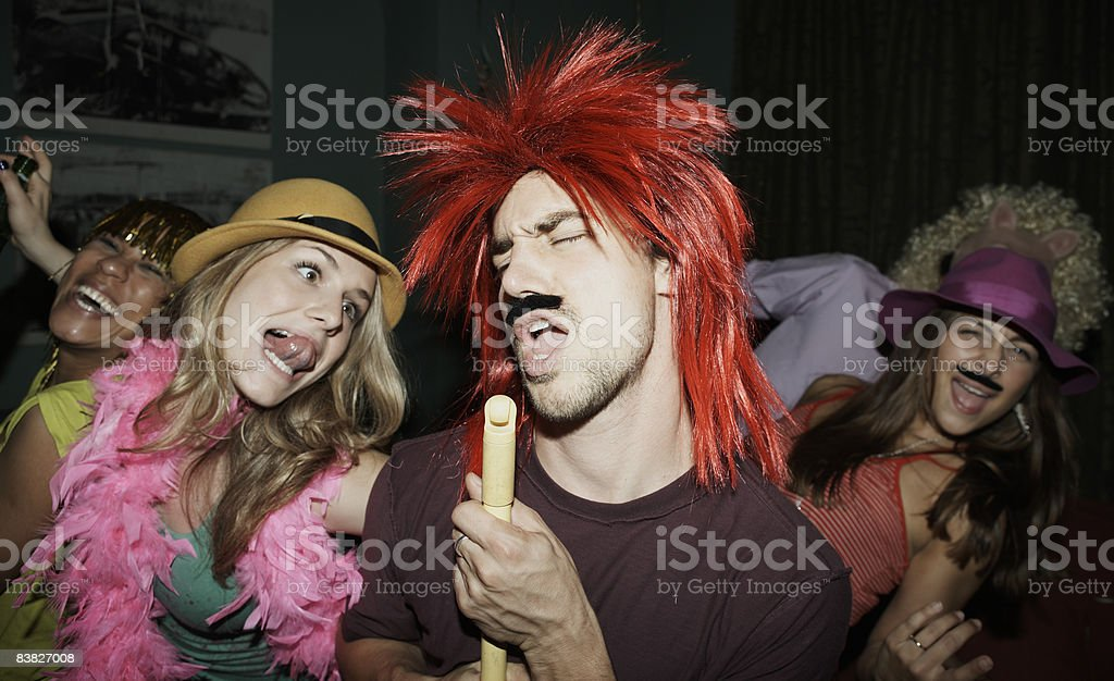 Friends dancing at party in costume royalty-free stock photo